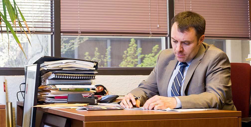 Rob DelCampo of Innovation Academy at desk