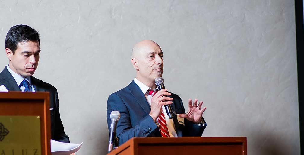 Man speaking at podium