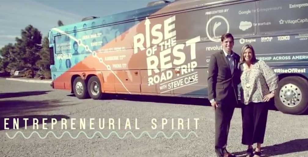 Two members of Rise of the Rest team outside their bus
